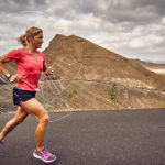 Anja Beranek monitoring her vital sign during excercise on a desert road