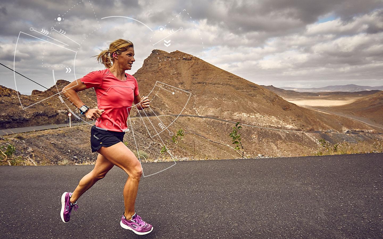 Anja Beranek monitoring her vital sign during excercise on a desert road