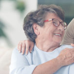 happy patient holding caregiver for a hand while spending time together