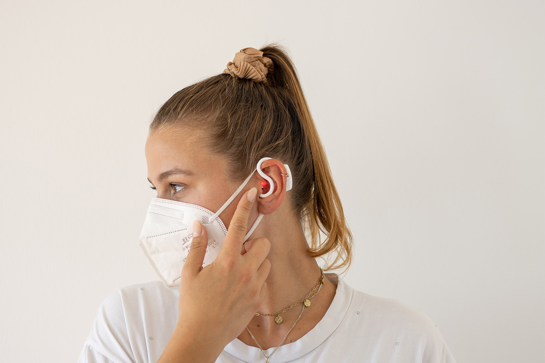 woman with c-med° alpha In-ear sensor
